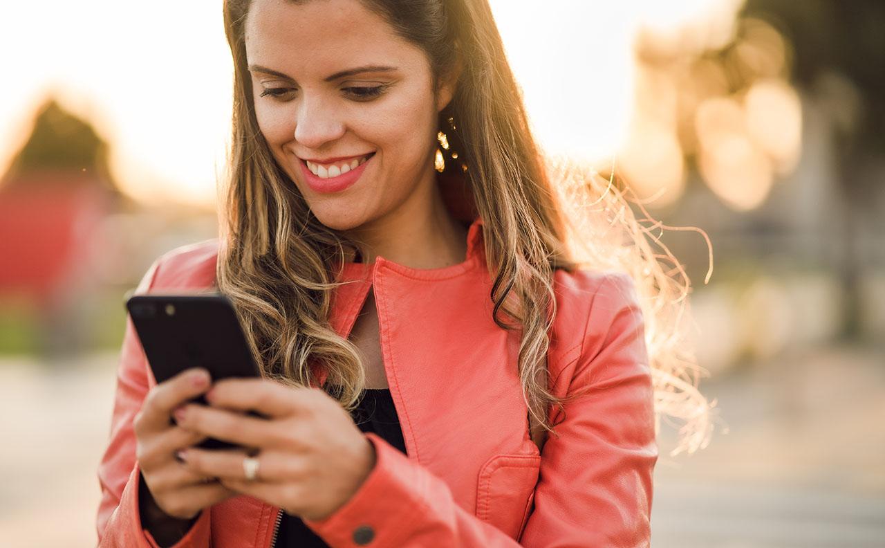 happy woman shops online via Google